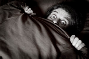 virgin male hiding under covers in fear picture